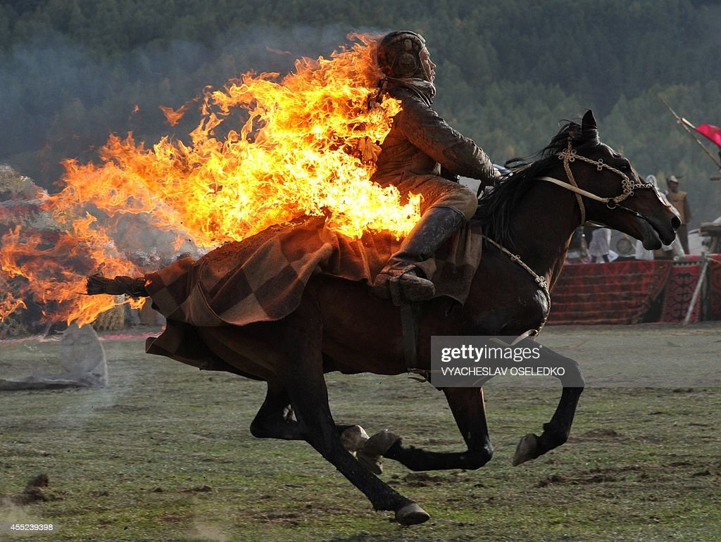 Photo taken on September 10, 2014 shows a Kyrgyz stuntman performing during the first World Nomad Games in the Kyrchin (Semenovskoe) gorge, some 300 km from Bishkek. Teams of Azerbaijan, Kazakhstan, Belarus, Mongolia and Tajikistan take part in the games.