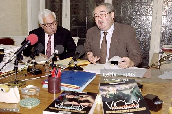 A photo taken on September 12 1989 in Paris shows French lawyer Serge Klarsfeld flanked by lawyer Charles Libman during a press conference about Rene...