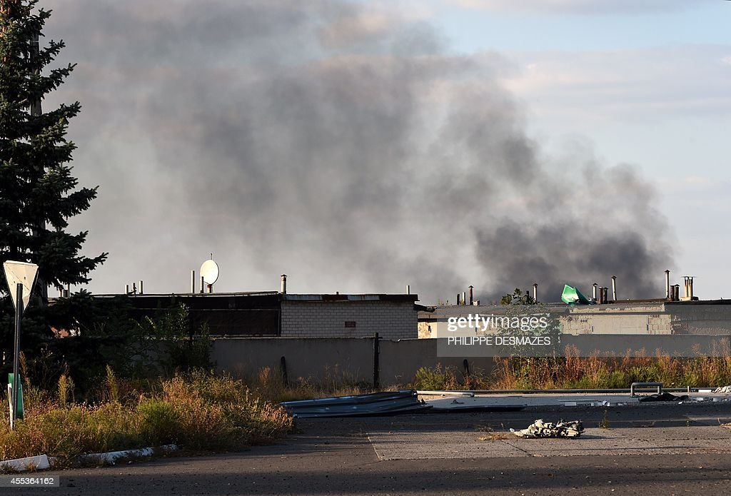 A photo taken on September 13 2014 shows smoke ascending around the Donetsk International Airport as shelling continues between proRussian forces and...
