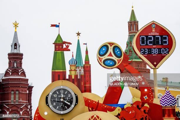 A photo taken on September 13 2017 shows the digital FIFA World Cup 2018 countdown clock placed in front of the Red Square and the Kremlin in Moscow...