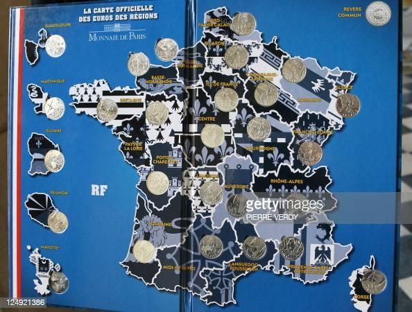 Photo taken on September 16 2010 at the Monnaie de Paris shows a book with 10euro coins from a new limited collection of coins bearing the names of...