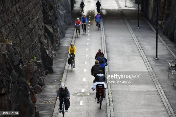 A photo taken on September 18 shows cyclists and pedestrians during morning traffic passing the 'Baana' road that was built on former train tracks...