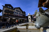 Photo taken on September 20 2012 shows people walking in a street of the Alpine resort of Gstaad in the canton of Bern Voters of the Swiss canton...