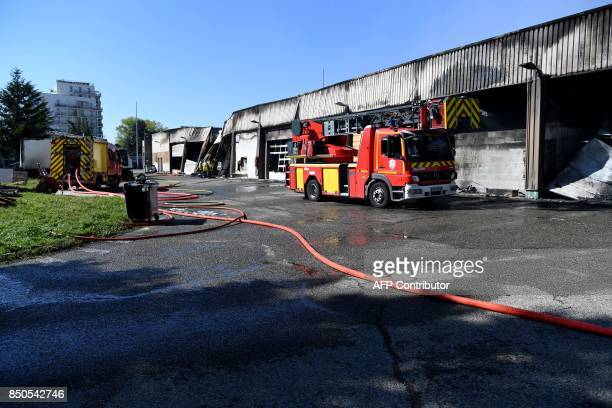 A photo taken on September 21 2017 in Grenoble eastern France shows a firefighter vehicle parked in front of a hangar of the French gendarmerie...