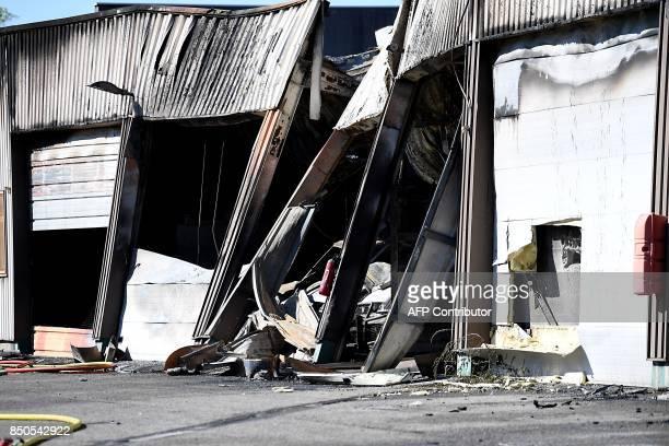 A photo taken on September 21 2017 in Grenoble eastern France shows a hangar of the French gendarmerie devastated by an arson Gendarmes investigate...
