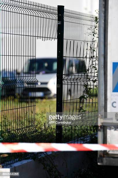 A photo taken on September 21 2017 in Grenoble eastern France shows an opening in a fence behind a security cordon a day after an arson devastated...