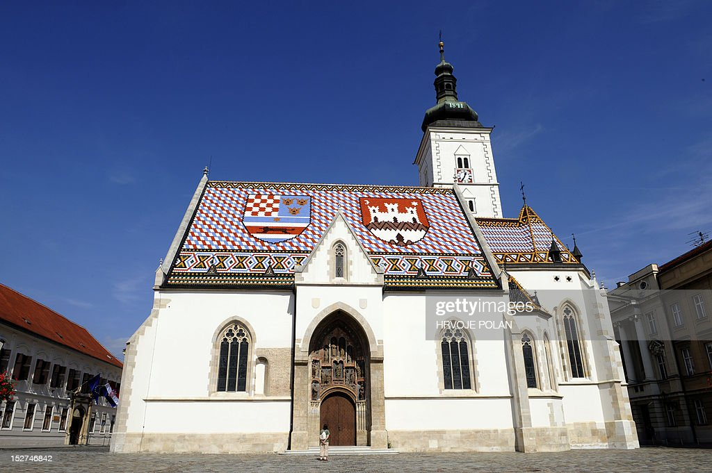 A photo taken on September 24, 2012 shows tiles on the roof of Saint-Marko church in the center of Zagreb, representing the coat of arms of Zagreb (R) and of the historic Triune Kingdom of Croatia, Slavonia and Dalmatia. AFP PHOTO/Hrvoje POLAN