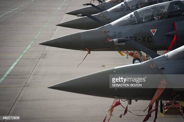A photo taken on September 25 2015 shows Dassault Mirage 2000D jet fighters at the Nancy Air Base in ThuilleyauxGroseilles during a military exercise...