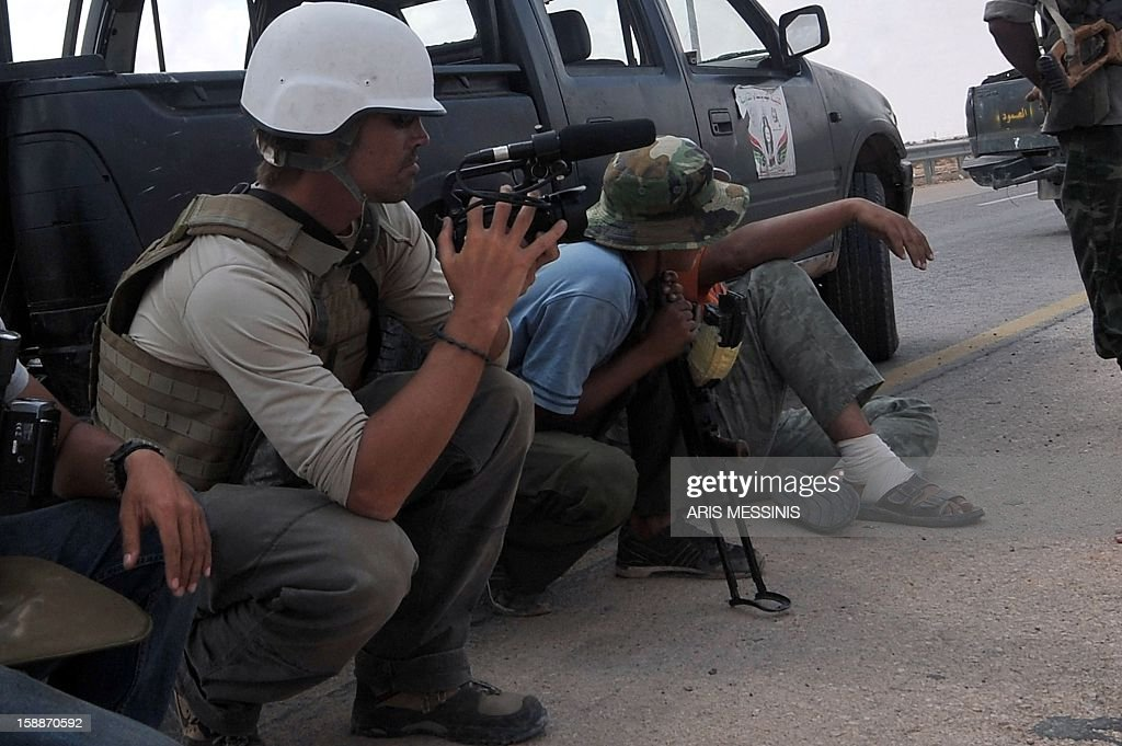 A photo taken on September 29 2011 shows US freelance reporter James Foley on the highway between the airport and the West Gate of Sirte Libya Foley...