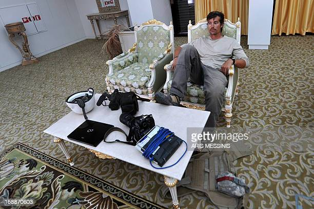 A photo taken on September 29 2011 shows US freelance reporter James Foley resting in a room at the airport of Sirte Libya Foley was kidnapped in...