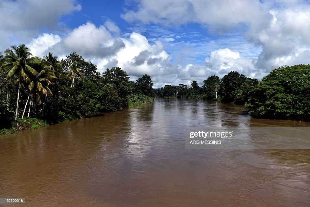A photo taken on September 3 2014 shows a view of the river near the town of Malalaua in the jungle of Papua New Guinea AFP PHOTO / ARIS MESSINIS