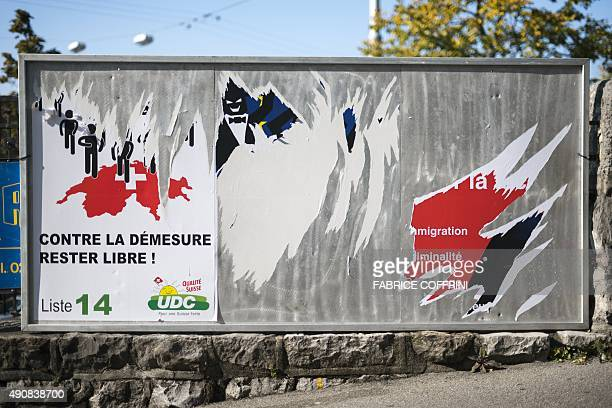 A photo taken on September 30 2015 shows ripped electoral posters of farright parties in a street of Lausanne Voters on October 18 2015 will elect a...