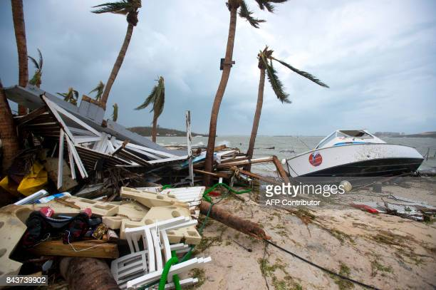A photo taken on September 6 2017 shows debris and a boat washed up onto shore in Marigot near the Bay of Nettle on the French Collectivity of Saint...