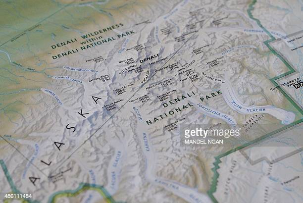 A photo taken onboard Air Force One enroute Alaska shows a National Parks Service map shows the newly renamed 'Denali' which was formerly known as...