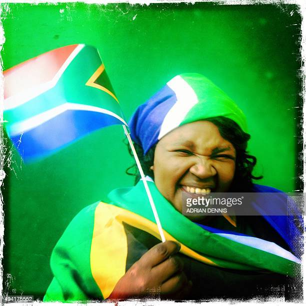 A photo taken with a mobile phone shows a South Africa supporter smiling prior to a semifinal match of the 2015 Rugby World Cup between South Africa...