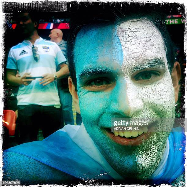 A photo taken with a mobile phone shows an Argentinian rugby fan with his face painted in the colours of Argentina's national flag pose for a...