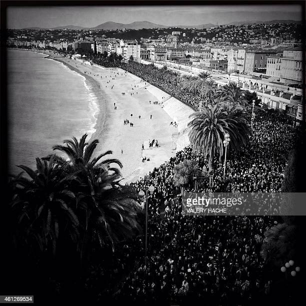 A photo taken with a mobile phone shows hundreds of thousands of people marching during a rally along the sea front in the Mediterranean city of Nice...