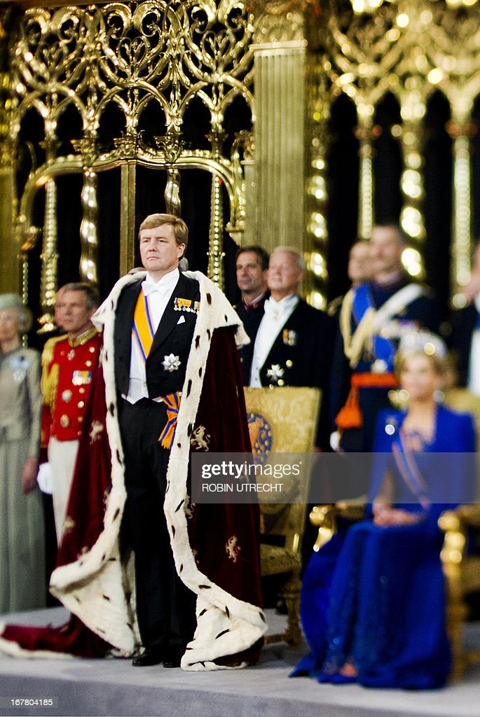 A photo taken with a tilt and shift lens shows King Willem-Alexander of the Netherlands (L) standing by his wife Queen Maxima during his inauguration at the Nieuwe Kerk (New Church) in Amsterdam on April 30, 2013.