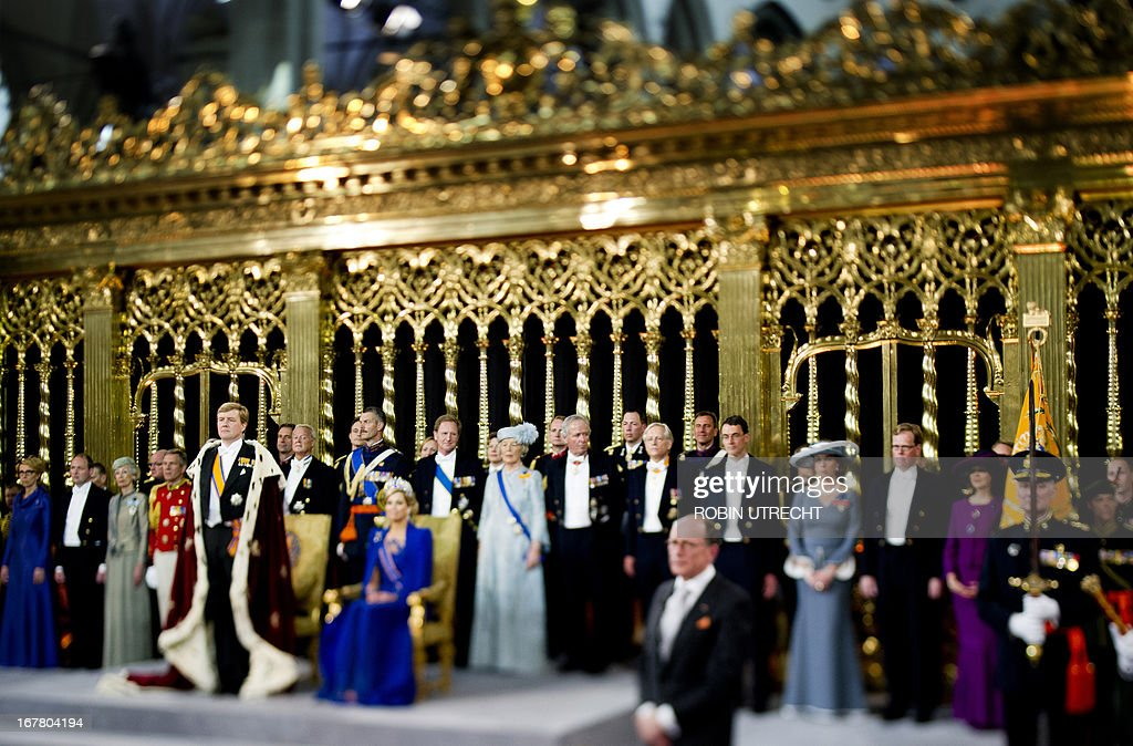 A photo taken with a tilt and shift lens shows King Willem-Alexander of the Netherlands (L) standing by his wife Queen Maxima and members of the royal household during his inauguration at the Nieuwe Kerk (New Church) in Amsterdam on April 30, 2013. AFP PHOTO / POOL / ROBIN UTRECHT