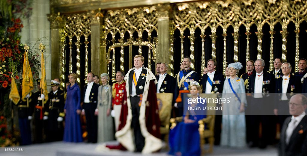 A photo taken with a tilt and shift lens shows King Willem-Alexander of the Netherlands (L) standing by his wife Queen Maxima and members of the royal household during his inauguration at the Nieuwe Kerk (New Church) in Amsterdam on April 30, 2013.