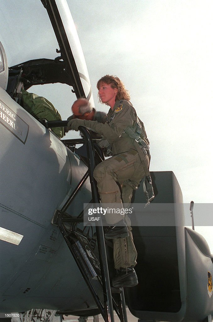 1st Lt. Jeannie Flynn, the first F-15E female pilot, climbs the ladder to board the aircraft. 1st Lt. Flynn is assigned to the 555th Fighter Squadron for six months for F-15E tactical training.