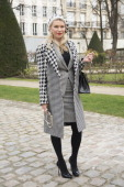 Photograher Zhanna Romashka wears Casadei shoes Eugenia Kim hat Marco Belogna suit Hermes bag and Chanel iphone case on day 4 of Paris Collections...