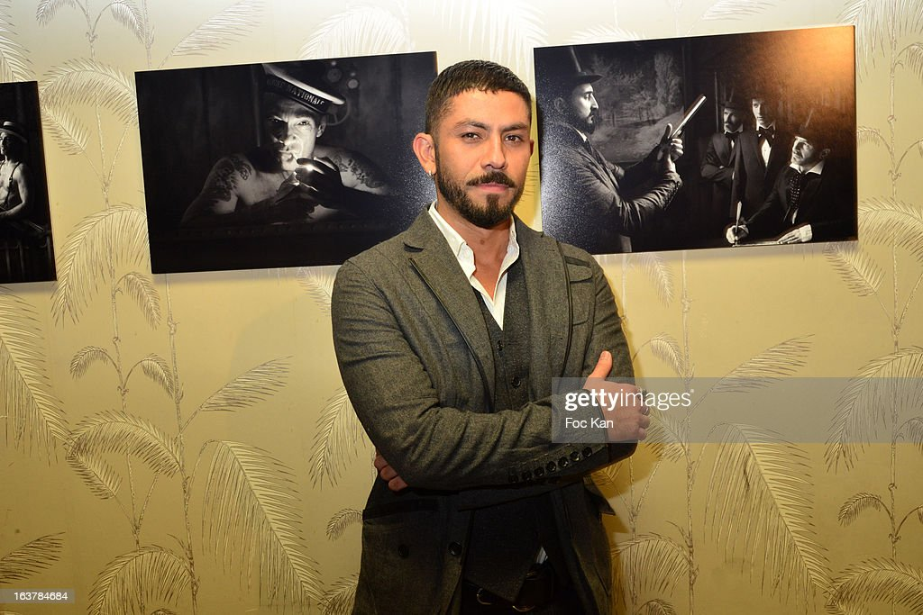 photograoher David Silva poses with his work during 'La Dance des Coincidences' Party At The Favella Chic on March15, 2013 in Paris, France.