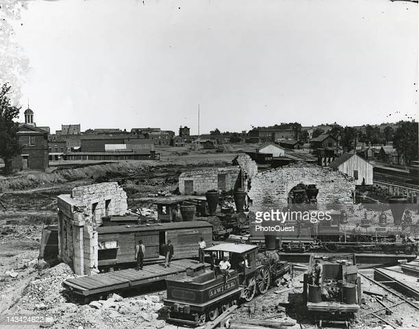 Photograph by George N Barnard show Confederate locomotives abandoned after the railroad facilities were destroyed just before the Union forces...