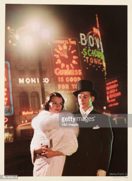 Photograph by Gordon Crocker Studio shot of a couple against a backdrop of the famous illuminated advertising hoardings in London�s West End
