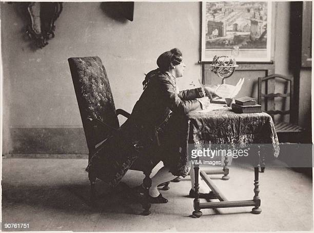 Photograph by Guido Rey of a man compiling an encyclopedia