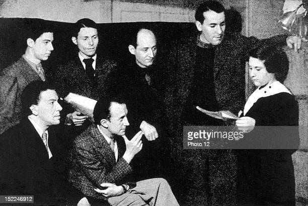 Photograph by Man Ray Group of surrealists JeanMario Prassinos Andre Breton Henri Parisot Paul Eluard Benjamin Peret Rene Char and Gisele Prassinos...