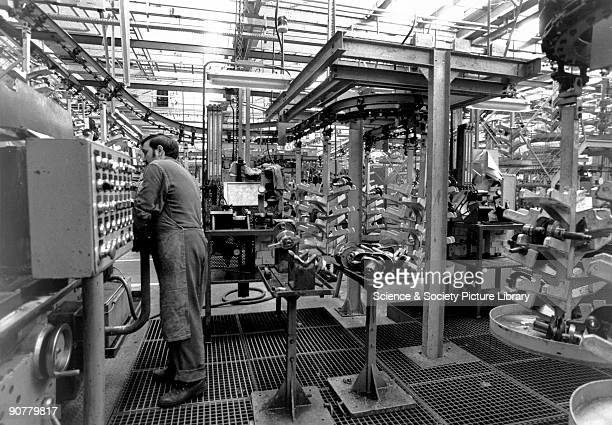 Photograph by Nick Thompson showing a worker operating a machine on a production line manufacturing the Citroen 2CV The first 2CV prototype was...