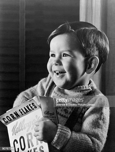 A photograph by Photographic Advertising Limited of a smiling little boy with his hand in a packet of Kellogg's Corn Flakes Images of children are...