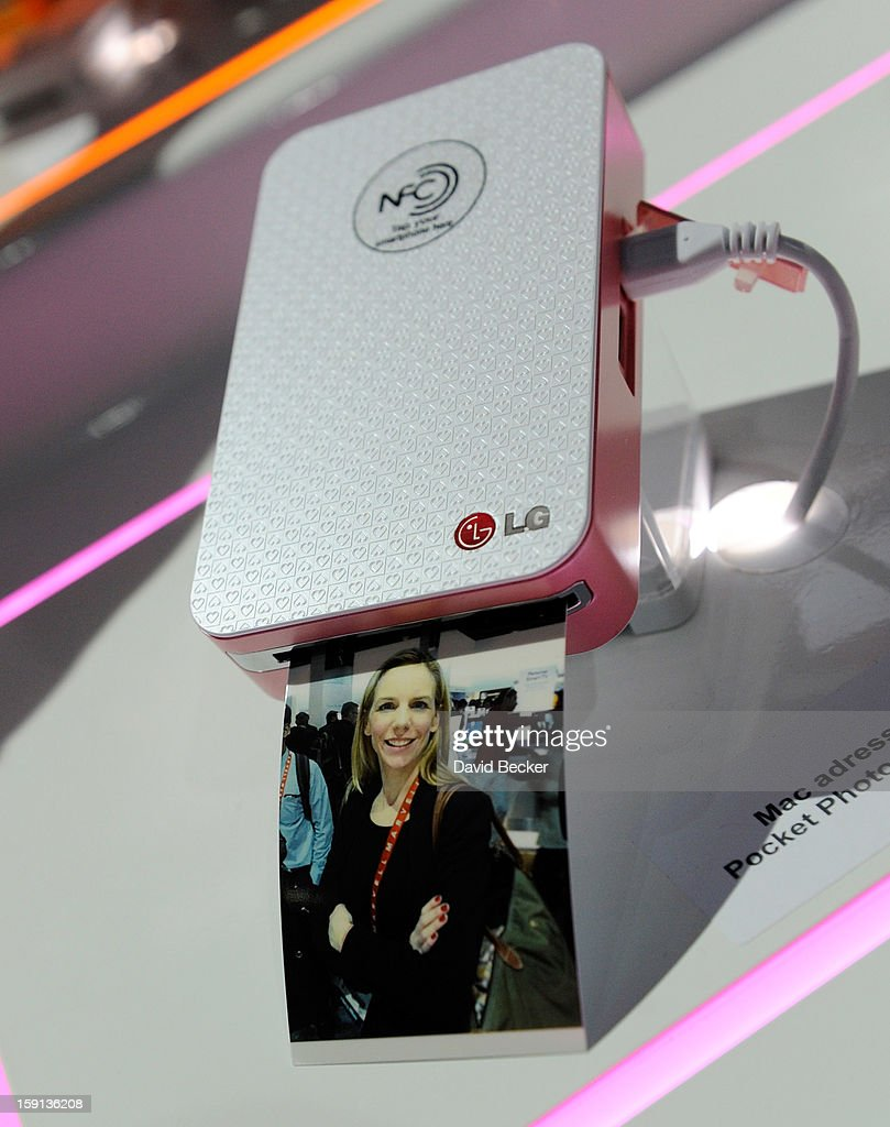 A photograph emerges from a LG Pocket Photo printer that uses NFC technology at the 2013 International CES at the Las Vegas Convention Center on January 8, 2013 in Las Vegas, Nevada. CES, the world's largest annual consumer technology trade show, runs through January 11 and is expected to feature 3,100 exhibitors showing off their latest products and services to about 150,000 attendees.