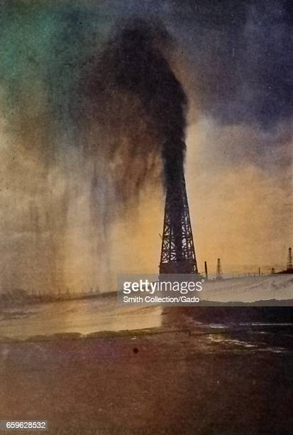 Photograph entitled 'Lakeview Gusher' showing an oil derrick with flowing oil installed by the Standard Oil company and operating using an electric...