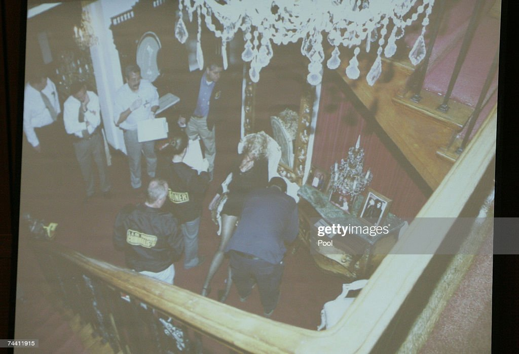 A photograph is projected as evidence detailing the view from the stairs in the foyer of Phil Spector's house, where investigators gathered around the body of Lana Clarkson, during the afternoon session of music producer Phil Spector's murder trial at Los Angeles Superior Court June 5, 2007 in Los Angeles. Spector, 67, is accused of the murder of actress Lana Clarkson, who was found shot dead in Spector's Alhambra, California mansion on February 3, 2003.