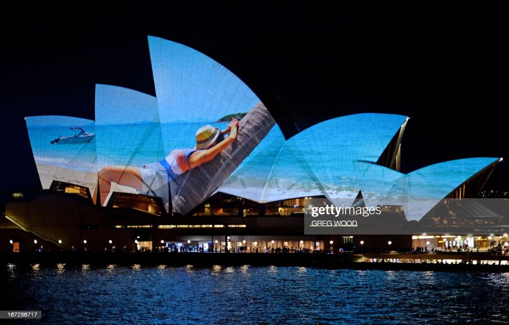 A photograph is projected onto the sails of the Opera House during the unveiling of the new Samsung GALAXY S 4 smartphone at the Sydney Opera House on April 23, 2013. Samsung Electronics Australia transformed the iconic sails of the Opera House into a visual display showcasing hundreds of photographs submitted by ordinary Australians. AFP PHOTO / Greg WOOD