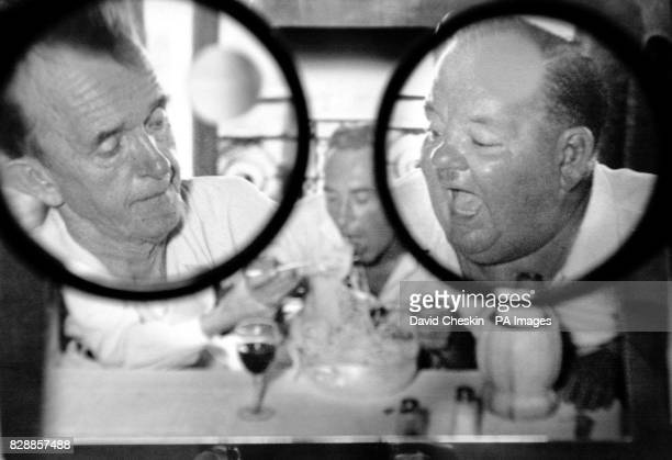 A photograph is viewed through glasses from an archive of stage and screen stars showing Stan Laurel and Oliver Hardy in Edinburgh The photographic...