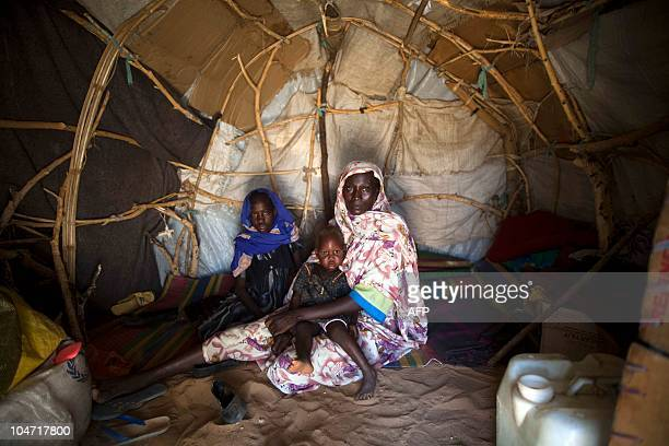 A photograph made available on October 4 by the United Nations and African Union Mission in Darfur shows new internally displaced refugee Ashia...