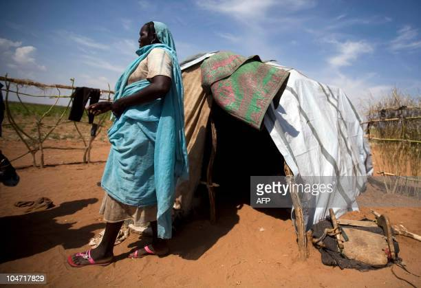 A photograph made available on October 4 by the United Nations and African Union Mission in Darfur shows new internally displaced refugee Maria Yahia...