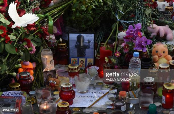A photograph of 10monthold Darina Gromova a victim of a jetliner crash is seen at a makeshift memorial outside Pulkovo International Airport in St...
