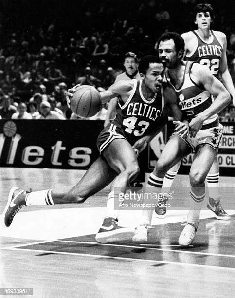 A photograph of a basketball game between the Boston Celtics and the Baltimore Bullets Washington DC 1970