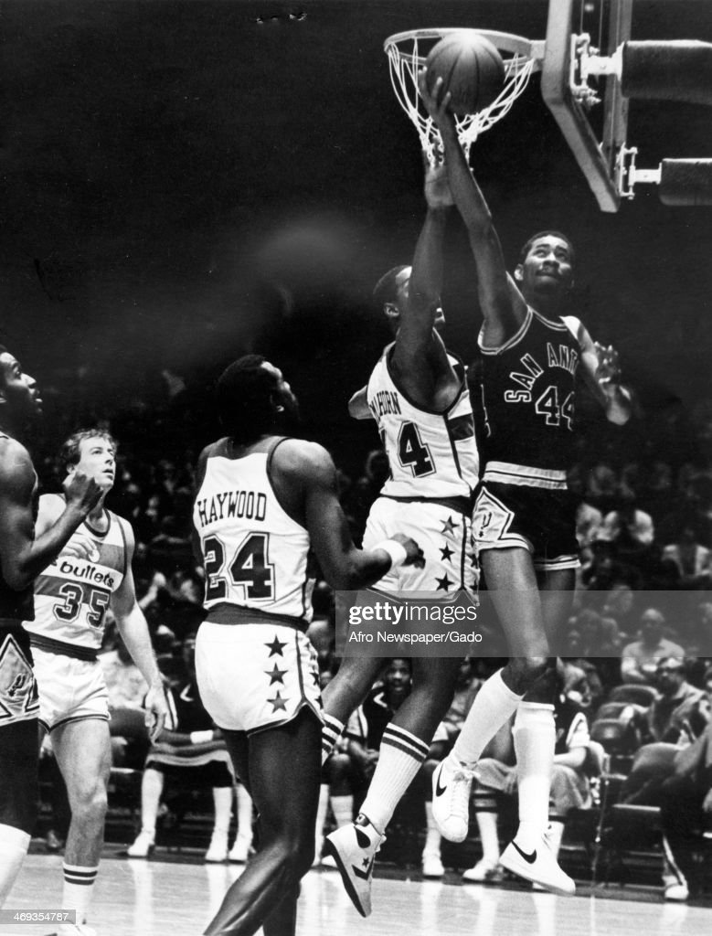 A photograph of a basketball match of the San Antonio Spurs vs Washington Bullets with San Antonio's George Gervin the 'Iceman' scoring a point 1980