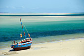 A Dhow at the water's edge on a beach in Mozambique