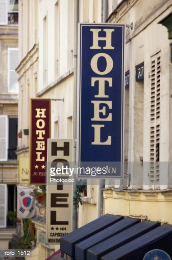 photograph of a european street lined with multiple hotel signs : Stock Photo