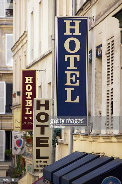 photograph of a european street lined with multiple hotel signs