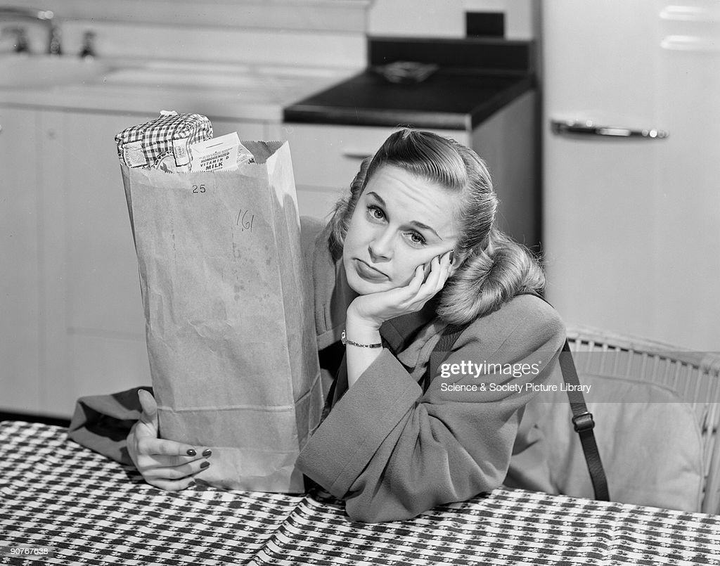 A photograph of a feduplooking woman with a bag containing milk and bread taken by Photographic Advertising Limited in the studio kitchen The company...