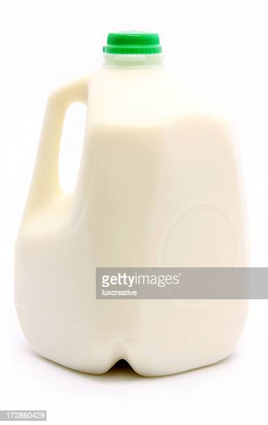 Photograph of a gallon of milk with a green cap
