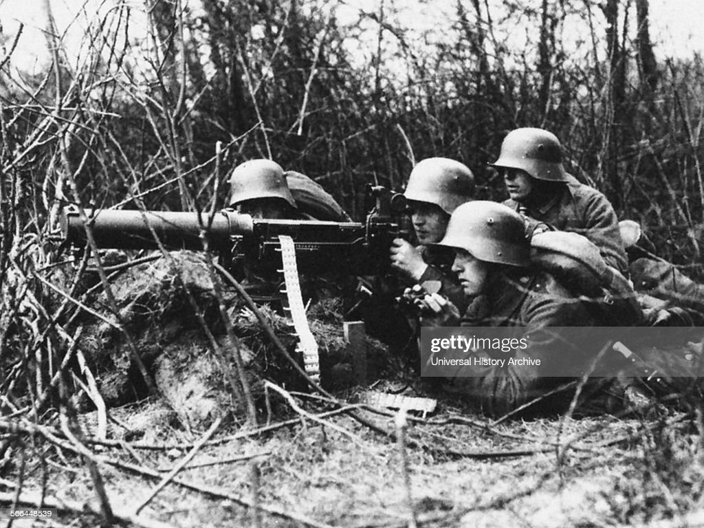Photograph of a German Machine Gun Crew in action during World War One Dated 1917