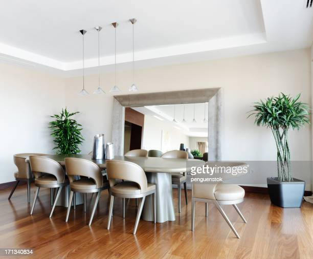 Photograph of a modern dinning room with wood floor